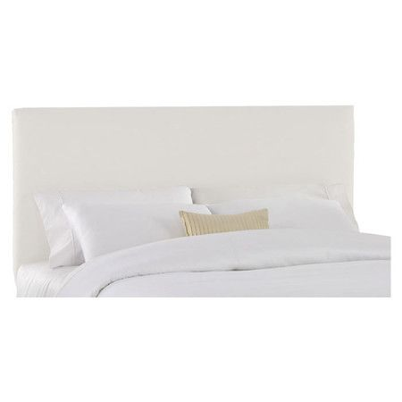 Cotton-upholstered pine wood headboard. Handmade in the USA.      Product: Headboard  Construction Material: Pine...