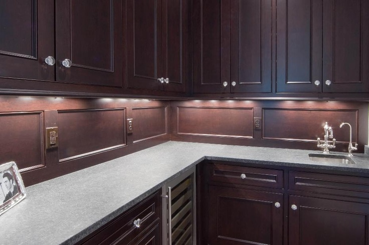 Traditional, dark wood kitchen cabinetry.