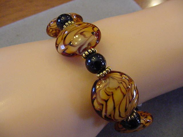 Round Chunky Animal Print Bracelet Chunky round glass beads with gold accents by…