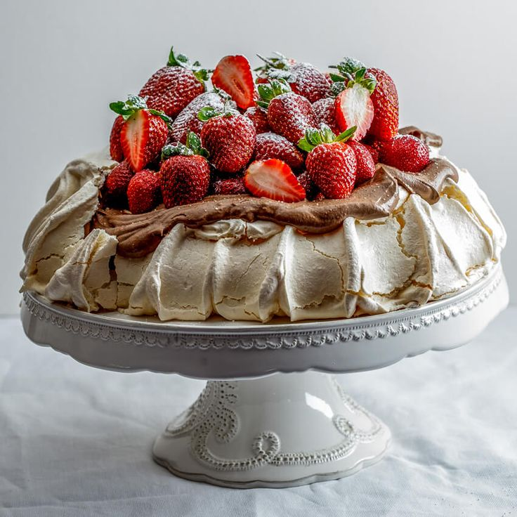 Pavlova with crisp exterior and soft, marshmallowy interior topped with easy chocolate cream and fresh strawberries is worthy of any celebration.