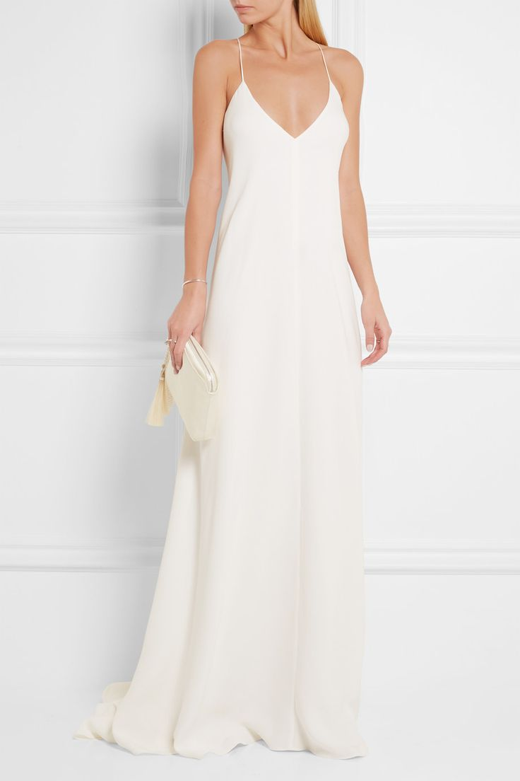 Calvin Klein Collection's 'Alessia' dress perfectly encapsulates the label's minimalist aesthetic. It has been expertly cut in Italy from swathes of ivory crepe de chine that beautifully skims over your curves and turns to reveal elegant crossover straps. We think it's perfect for evening events or understated beach weddings.   Shown here with: The Row Clutch, Tamara Mellon Sandals, Maison Margiela Cuff, Cornelia Webb Rings.