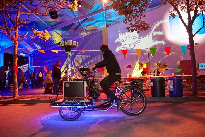 <p> The large tents that housed sessions during the day became canvases for pop-up artwork during the opening night Block...