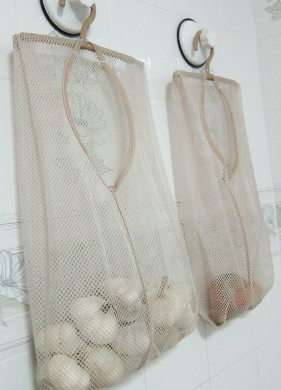 Mesh laundry bags are a great way to store produce that should be ventilated. | 51 Game-Changing Storage Solutions That Will Expand Your Horizons