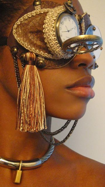 Steampunk goggles with pocket watch. I love the use of the tassles