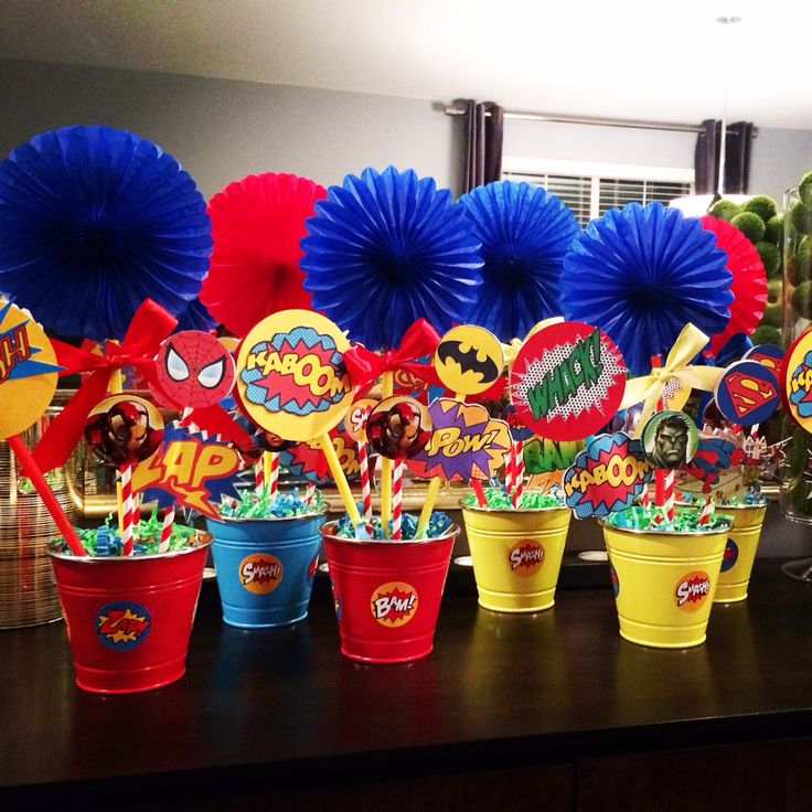 Superhero Centerpieces using free printables, straws and fans from Party City.