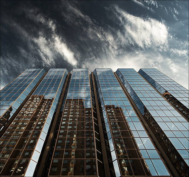 great use of the reflective surface of one building to take a pic of the other - reflecting_building_633_dark-sky_01 ... http://www.flickr.com/photos/wvs/310109651/