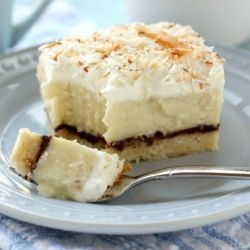 Amazing Coconut Cream Pie Bars with a layer of rich, dark ganache and a shortbread crust.