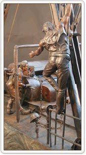 The Derrick Floor History In Bronze - Artesia Mainstreet | Downtown - Artesia, New Mexico