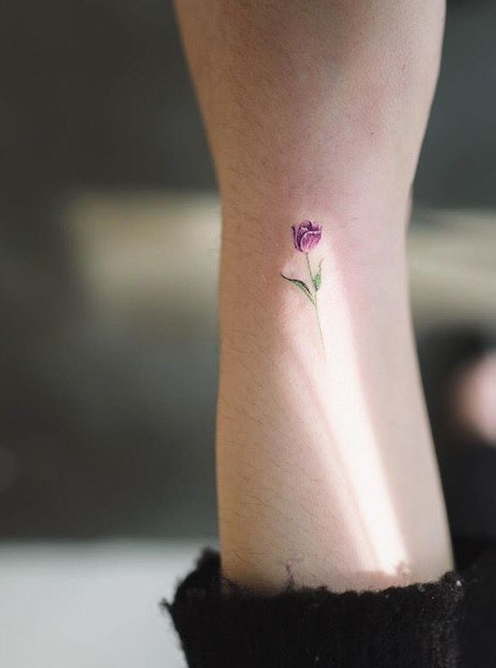Tiny colourful tulip tattoo on the wrist. #flower #tulip #tattoo                                                                                                                                                                                 More