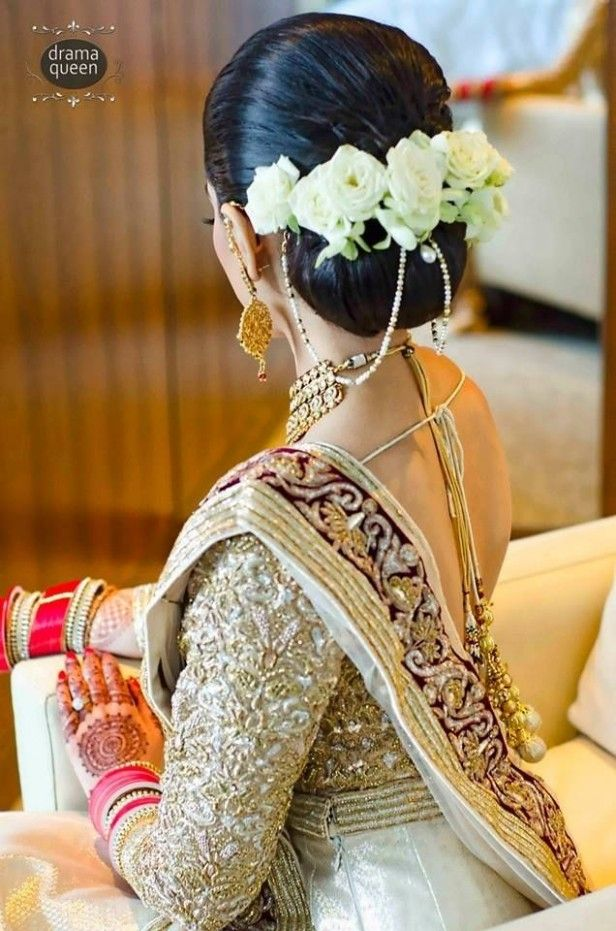 Indian Wedding Hairstyle With Flowers In 2020 Indian Bridal Hairstyles Indian Wedding Hairstyles Bride Hairstyles