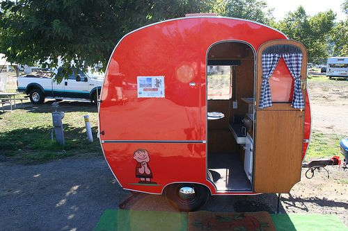 Early 60's German camper - all 6 or 7 feet of it. Great Lucy red and shiny -- perfect for a bug to tow
