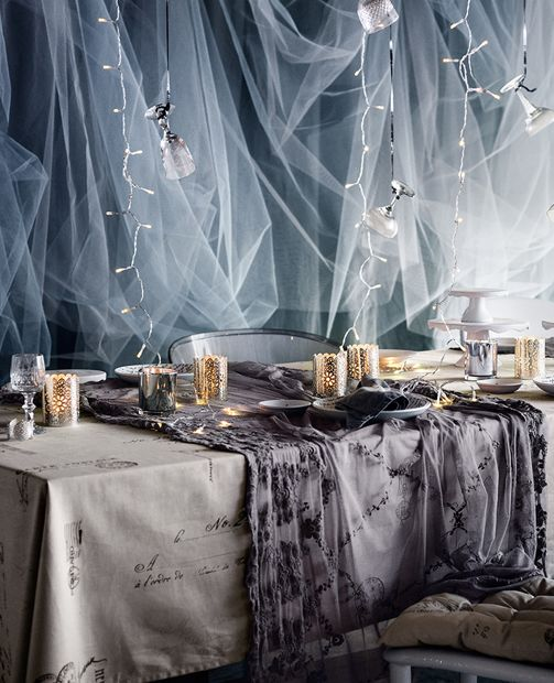 silver and grey table setting for the holidays
