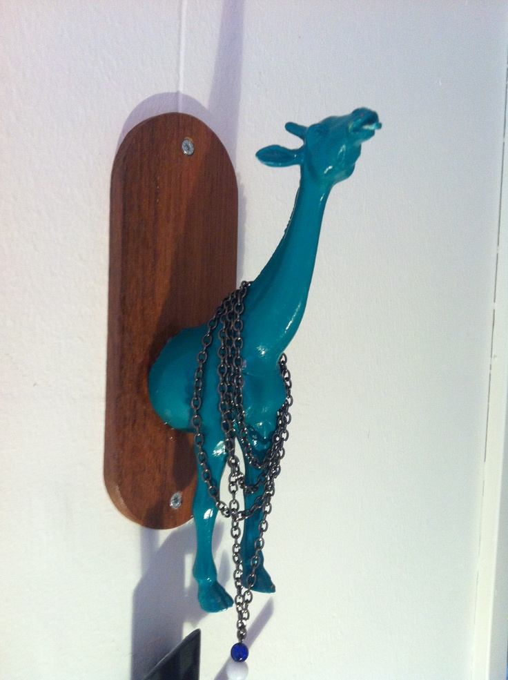 A giraffe for necklaces. Fun craft To Do! I stuffed the giraffe with rice And a thick layer of hot glue, then drilled it To the board.