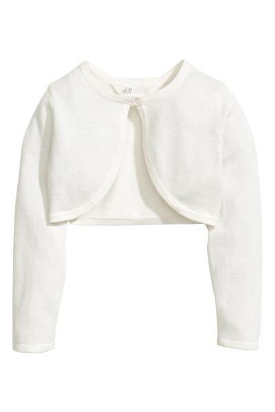 Vestido en sirsaca con tirantes finos, parte superior de corte ajustado, elástico en el escote y bajo redondeado con ligero vuelo.
