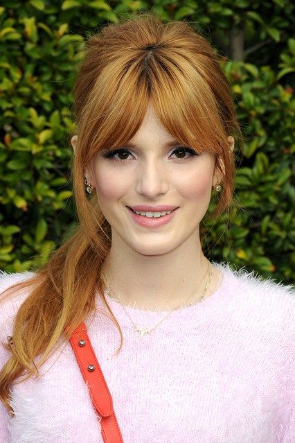 Disney's Bella Thorne's thick and glossy, centre-parted highlighted bangs are amongst the best we've seen in ages.