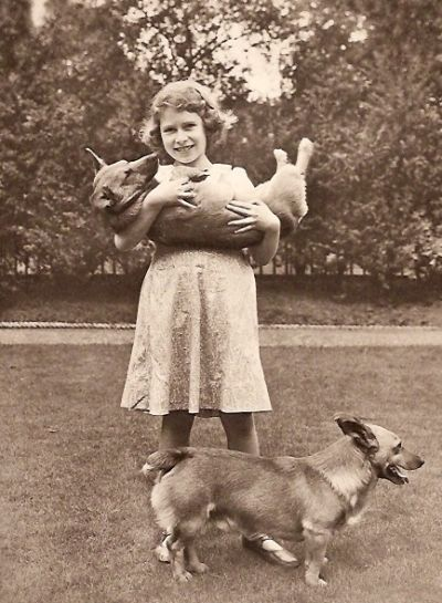 Princess Elizabeth and her corgis  (The Future Queen of England) She keeps Corgi Dogs into her most golden years!