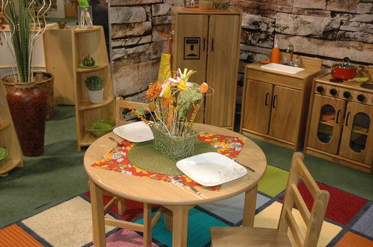 Daycare or preschool play kitchen decoration idea following principals of Inspiring Spaces for Young Children book (similar to Reggio Emilia Approach). [Image from Kaplan Early Learning Company booth at NAEYC 2010]