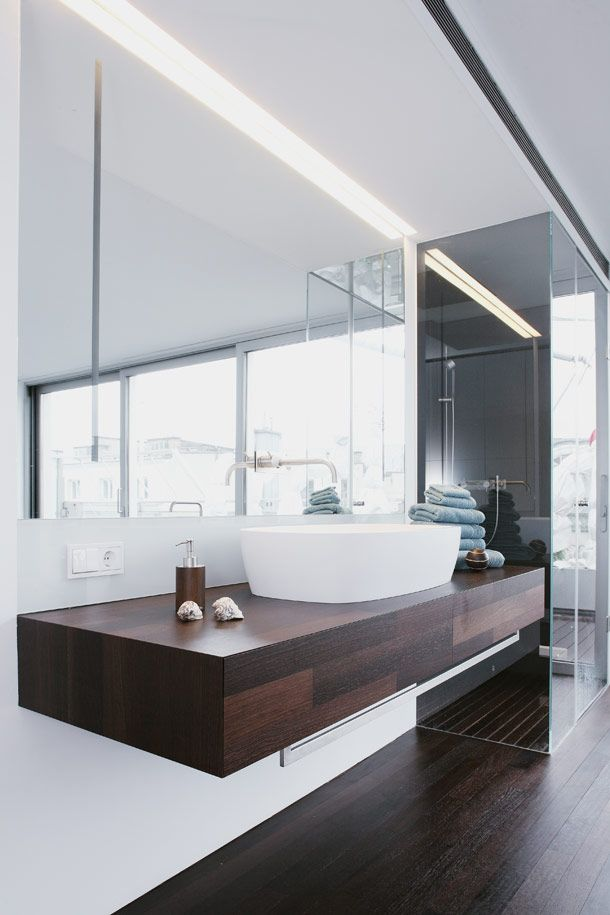 Open Bedroom/Bathroom. Suspended Sleek Vanity Unit With Flash Fitted Mirror  Cabinet And Concealed
