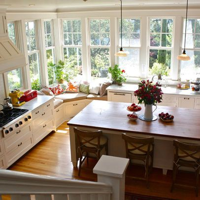 One of our favorite kitchen pics Love the extra tall windows Love that they wrap around the corner Love the unexpected window seat in corner (we really use our current bench seat in the kitchen to relax and chat) Like the cupboards and wood floors Not crazy about the wood counter on island