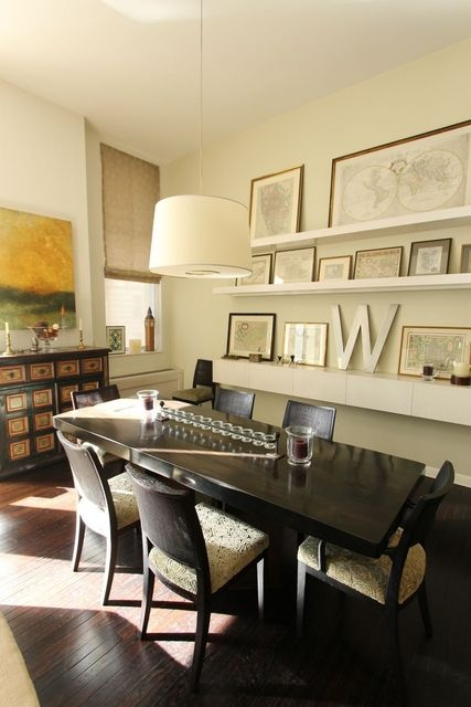 Floating wall shelving in dining area for small frames/books/collections.