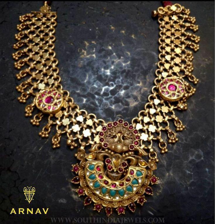 Superfect gold antique necklace model from Arnav. For mor details please contact. Seller Name : Arnav Contact No : +91-767676 1216 Address : #17, 9th Main, 2nd Jayanagar, Opp Govt Nursing Home, Bengaluru, Karnataka 560011, India Email : contactus@arnav.in Website : http://www.arnav.in/ Related PostsNavarathna Necklace From ArnavAntique Gold Emerald Pendant From ArnavGold Kemp Ruby Pendant …