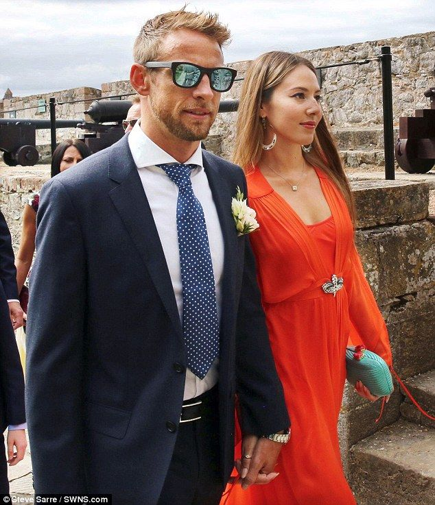 Stepping out: Formula 1 champ Jenson Button, 35, and his model wife Jessica Michibata, 30, were pictured putting on a brave face as they attended the wedding of Jenson's manager, Richard Goddard