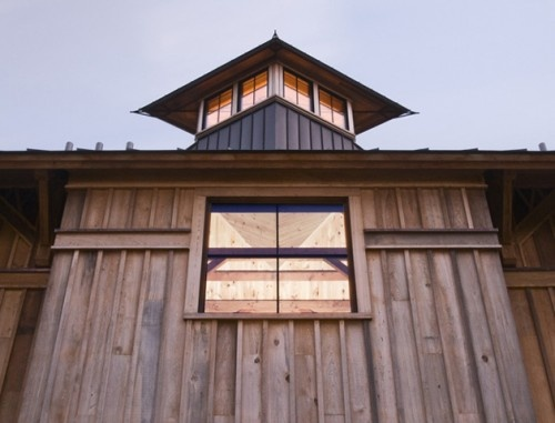 Eclectic barn exterior by Birdseye Design