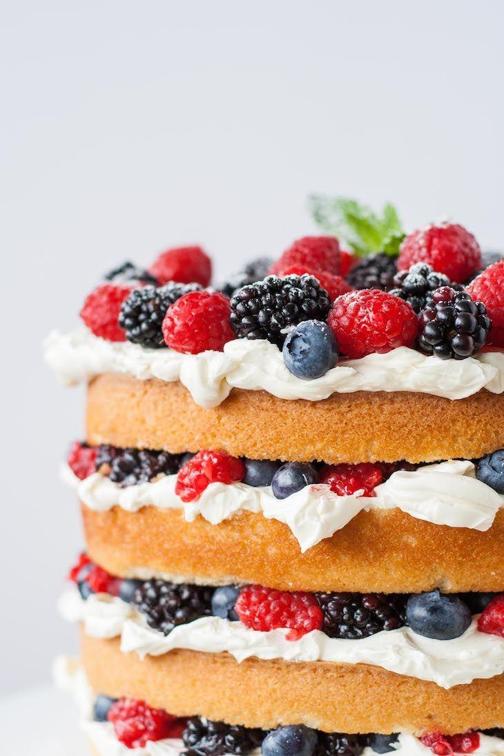 Layers of vanilla cake, swiss meringue buttercream, and loads of fresh berries.   livforcake.com