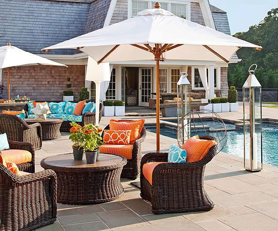 Complementary colors create a bright color scheme for this pool side patio.  See more ideas