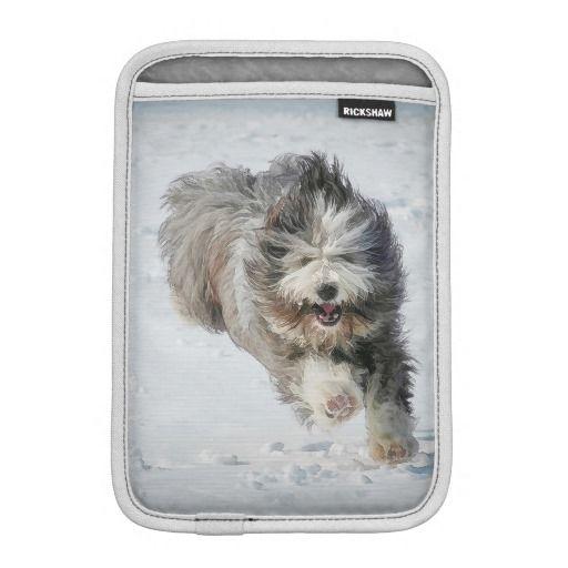 Bearded collie running in the snow iPad Mini. Slim and super protective – meet the custom Rickshaw iPad Mini sleeve.