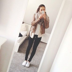 Fall style. Brown leather jacket, champagne colored scarf, black jeans, white shoes.