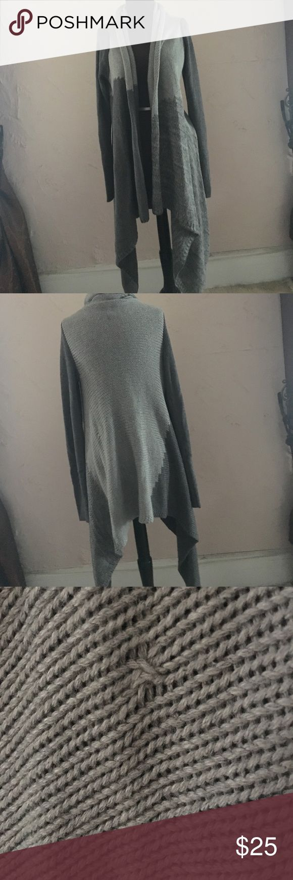 Calvin Klein sweater Light and dark gray sweater, long in front, factory small defect ( see picture) besides that perfect condition Calvin Klein Jeans Sweaters
