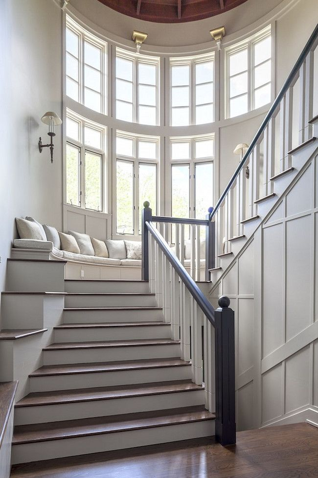 These bay windows paired with Simply White paint by Benjamin Moore accentuate natural lighting the stairwell.