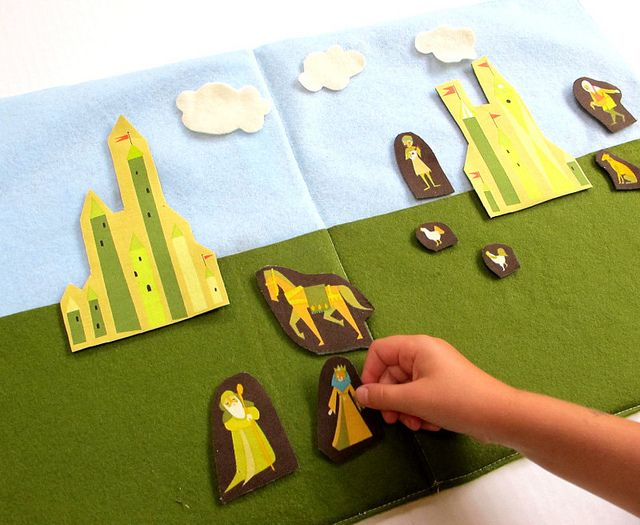 Castle Fabric cut out pieces sewn onto felt backgrounds. READ WHOLE POST! Blue Felt Sky with green felt grass that isn't tacked down so the pieces store behind it!!