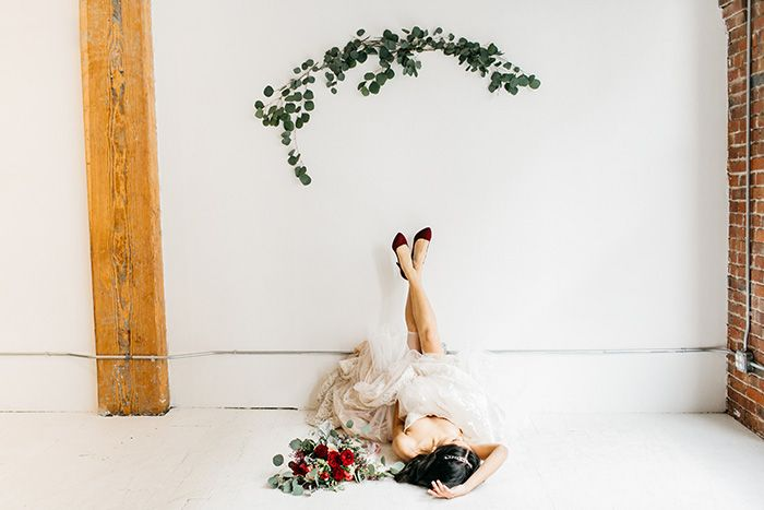 Bride Lounging in her Wedding Dress