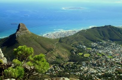 A panoramic view of Lions Head, Signal Hill, Robben Island, and Cape Town, South Africa, as seen from the top of Table Mountain.