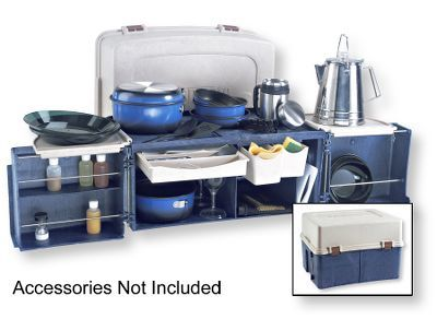 The Campmate camping kitchen is a huge plastic box; the top comes of leaving space for a 2-burner stove and two doors which swing out and form a work surface. The doors have enough space for spices and the rest of the box holds plates, cups, silverware and pots, with everything in its own space.