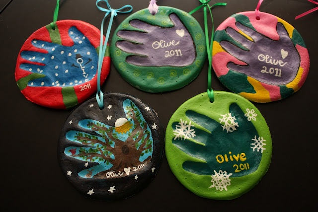 DIY handprint ornaments would be such a cute tradition to do every year and let the kids paint their own!