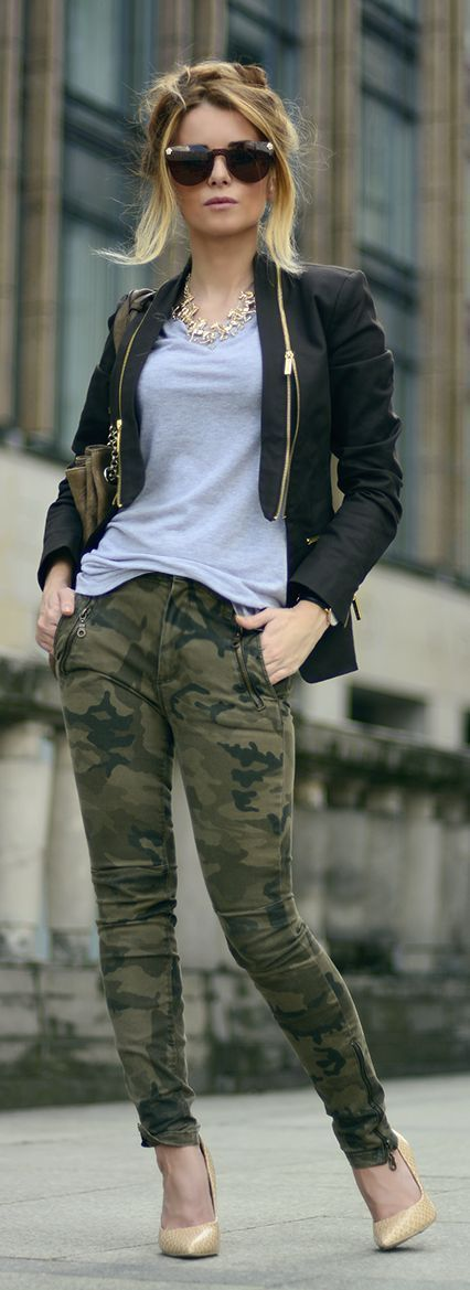 Team a black leather jacket with olive camo skinny jeans to achieve a chic look. Finish off your look with tan leather pumps.   Shop this look on Lookastic: https://lookastic.com/women/looks/jacket-v-neck-t-shirt-skinny-jeans/19762   — Dark Brown Sunglasses  — Gold Necklace  — Grey V-neck T-shirt  — Olive Leather Tote Bag  — Black Leather Jacket  — Olive Camouflage Skinny Jeans  — Tan Leather Pumps