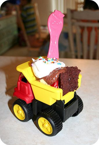 Mini dump truck cake.  I don't have a son small enough to like this idea but I thought it was too cute not to repin.  Maybe I will do this for my next boy daycare kiddo's birthday.