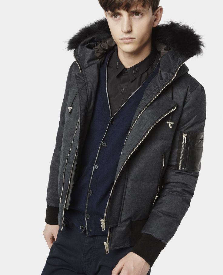 Short zipped down jacket with fur hood and leather pocket - Coats ...