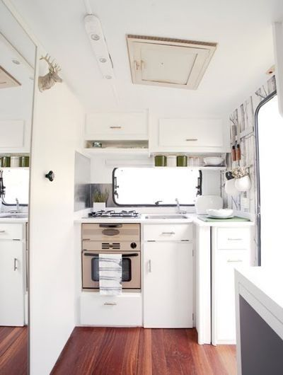 Vintage trailer inside, remodeled kitchen area <3