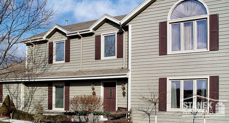 Two- and three-lite casement windows add a modern look to this Milwaukee home. A half-circle window finishes the look. Learn more.