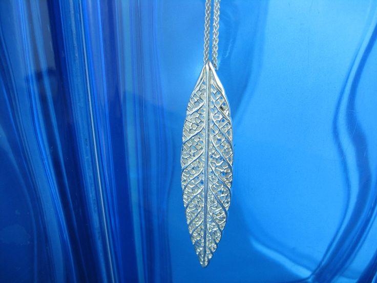a delicate lace like leaf necklace in sterling silver