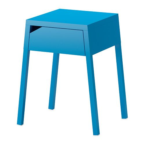 A small bright turquoise side table with a drawer