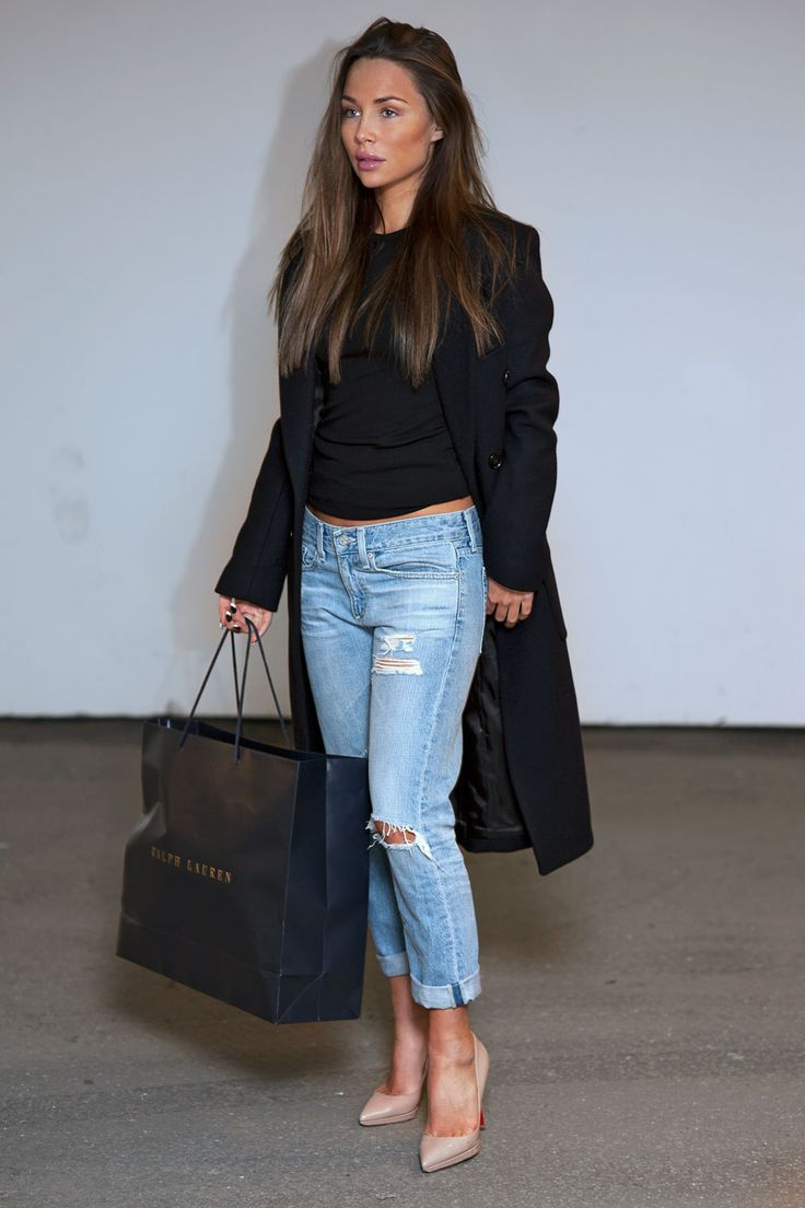 Boyfriend jeans, cropped black sweater, nude heels and a great coat.