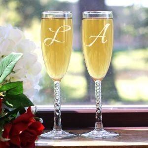 Monogrammed champagne glasses for wedding reception.  See more champagne bubble candy wedding favors and party ideas at www.one-stop-party-ideas.com