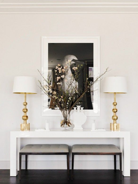 Black And White Art, Gold Lamps, Benches Under The Console (Design By Samantha Todhunter Via My Domaine)