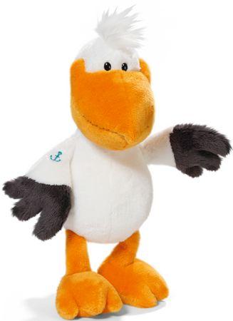 """Pelikan to idealny zwiastun wakacji. Jego ramię zdobi """"morski"""" tatuaż."""