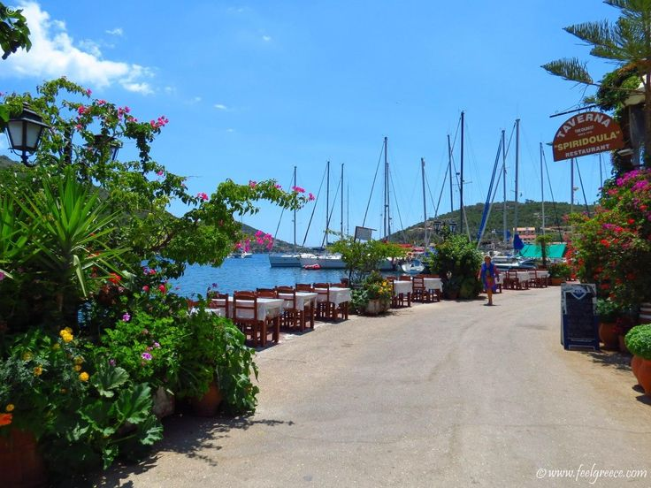 The promenade of Sivota, a natural bay and marina with yachts and boats to rent on Lefkada
